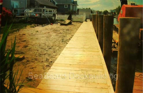 a wooden deck along the water's edge