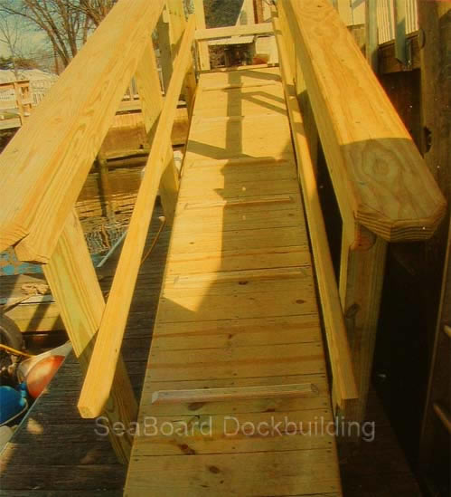 a wooden gang plank style ramp with safety tread