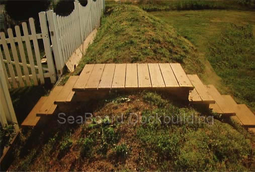 wooden steps over a protective hill of dirt
